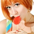 Beautiful red girl with candy — Stock Photo #2354447