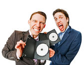 Two businessmen holding DVDs — Stock Photo