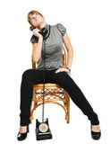 Young woman sitting on a chair — Foto Stock