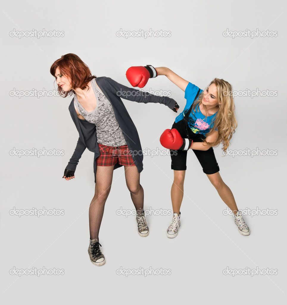 Young beautiful girls fighting isolated on white background — Stock Photo #2354368