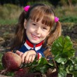 The girl with a beet - Stock Photo