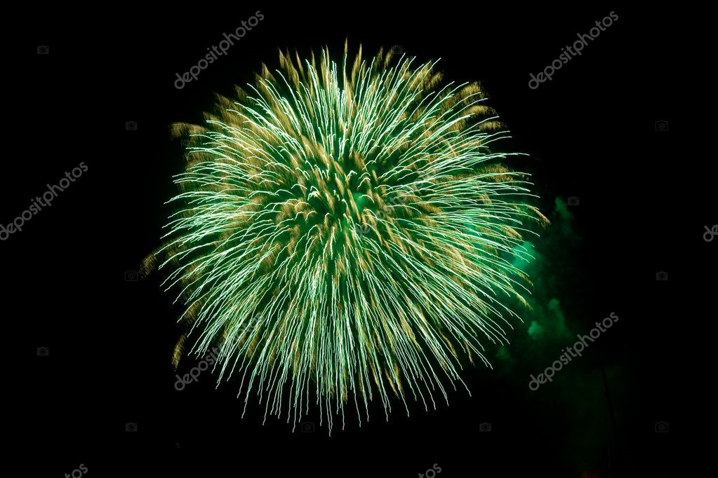 Green fireworks exploding on a black sky.  Stock Photo #2372558