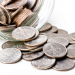 Quarters 25 cents change coins in a jar — Stock Photo