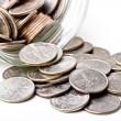 czwarte 25 centów zmienić monet w słoiku — Zdjęcie stockowe
