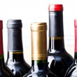 Stock Photo: Bunch of unopened wine bottles isolated