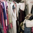 Messy unorganized closet full of clothes - Stock Photo
