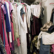 Stock Photo: Messy unorganized closet full of clothes