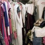 Messy unorganized closet full of clothes — Stock Photo