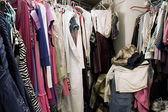 Messy unorganized closet full of clothes — Stock Photo