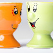 Pair of  ceramic egg holders happy faces - Stock Photo