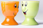Pair of ceramic egg holders happy faces — Stock Photo