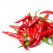 Stock Photo: Red spicy hot chili peppers isolated