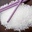 Sea bath salt with lavender sticks - Stock Photo