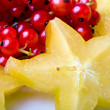 Stock Photo: Exotic tropical star fruit red currant