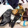 Shoes on a cluttered messy closet floor - Stock Photo