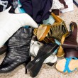Stock Photo: Shoes on cluttered messy closet floor