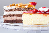 Delicious gourmet cheese cake desserts — Stock Photo