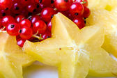 Exotic tropical star fruit red currant — Stock Photo
