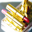 Set of two red pink lipsticks — Stock Photo