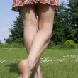 Stock Photo: Womlegs relaxing on sunny garden