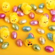Royalty-Free Stock Photo: Easter eggs and chicks  over yellow