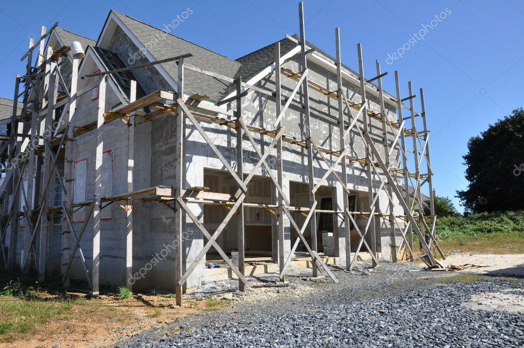 New home construction with scaffolding by the home for stucco work  Stock Photo #2352170