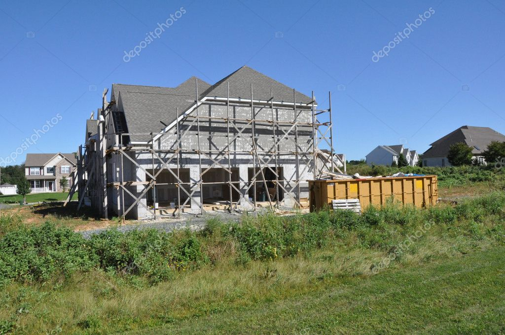 New home construction with scaffolding for stucco — Стоковая фотография #2352181