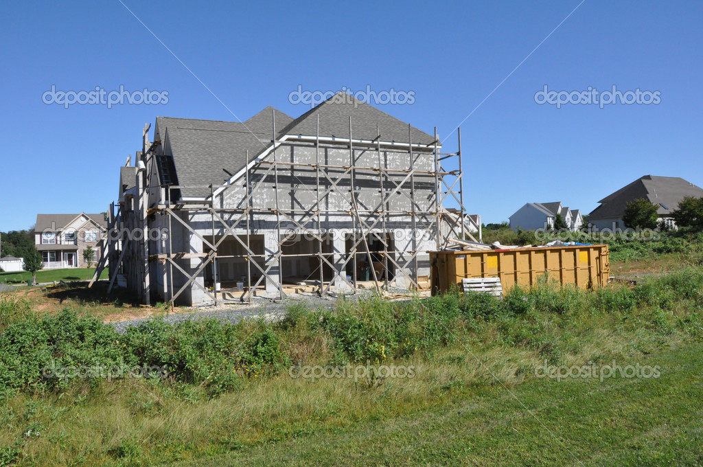 New home construction with scaffolding for stucco — Stok fotoğraf #2352181