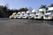 Many tractor trailers — Stock Photo