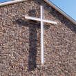 White cross on stone church building — Stock Photo #2427241