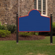 Stock Photo: Blank sign by stone building