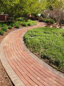 Winding brick path in a garden — Stock Photo
