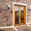 Stock Photo: Wood doors by stone building