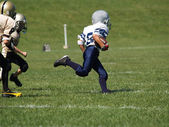 Young football runner — Foto Stock