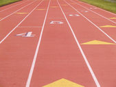 Numbered lanes on a running track — Stock Photo