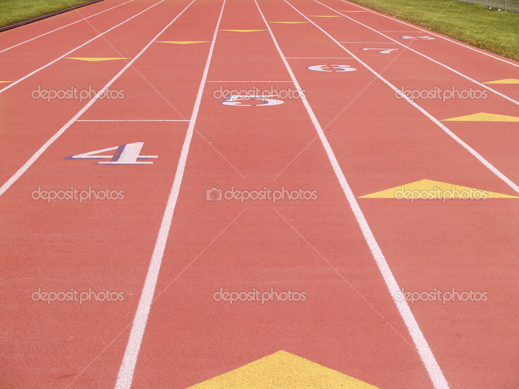 Numbered lanes on an outdoor running track — Stock Photo #2448092