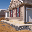 A new sidewalk by a home construction - Stock Photo