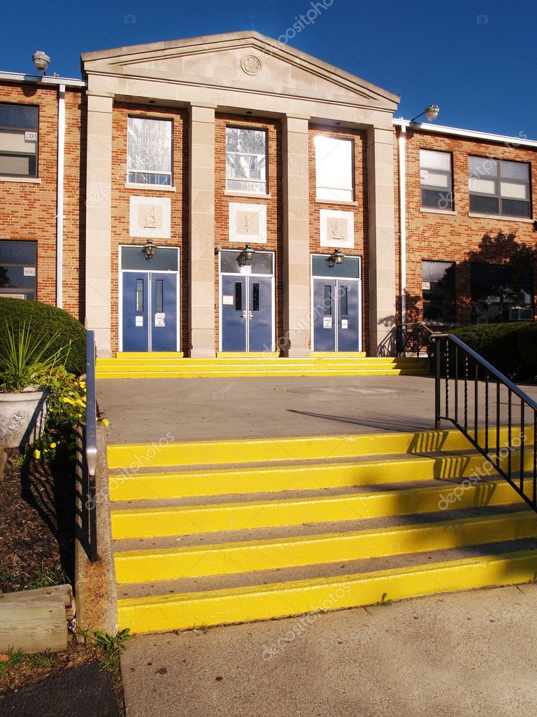 Front entrance and steps for an old catholic high school — Stock Photo #2463069