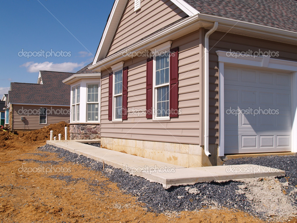 A new sidewalk poured by a new home under construction — Stock Photo #2469210
