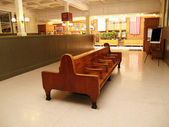 Old wood benches in a train station — Stock Photo