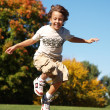 Stock Photo: Young boy jumping in air