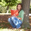 Teenage girl reading a book — Stock Photo
