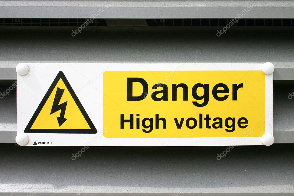 A picture of a sign for high voltage depicting a yellow triangle with arrow and a rectangle with words. — Stock Photo #2495718