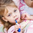 Ill Child with Thermometer - Stock Photo