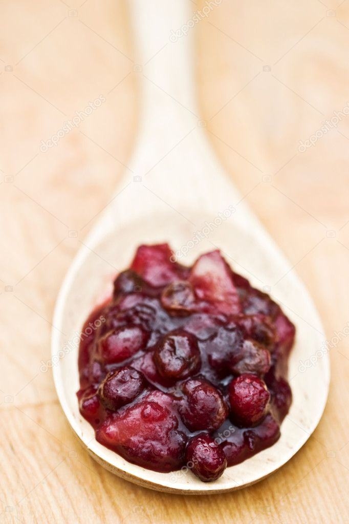 Large wooden spoon filled with homemade cranberry relish made with whole cranberries, raisins and apples.  — Stock Photo #2503877