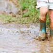 Playing in mud puddle — Stock Photo #2528335