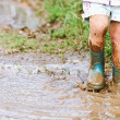 Playing in a mud puddle — Stock Photo