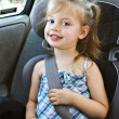 Little girl in a car seat - Stockfoto