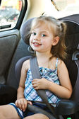 Little girl in a car seat — Stockfoto