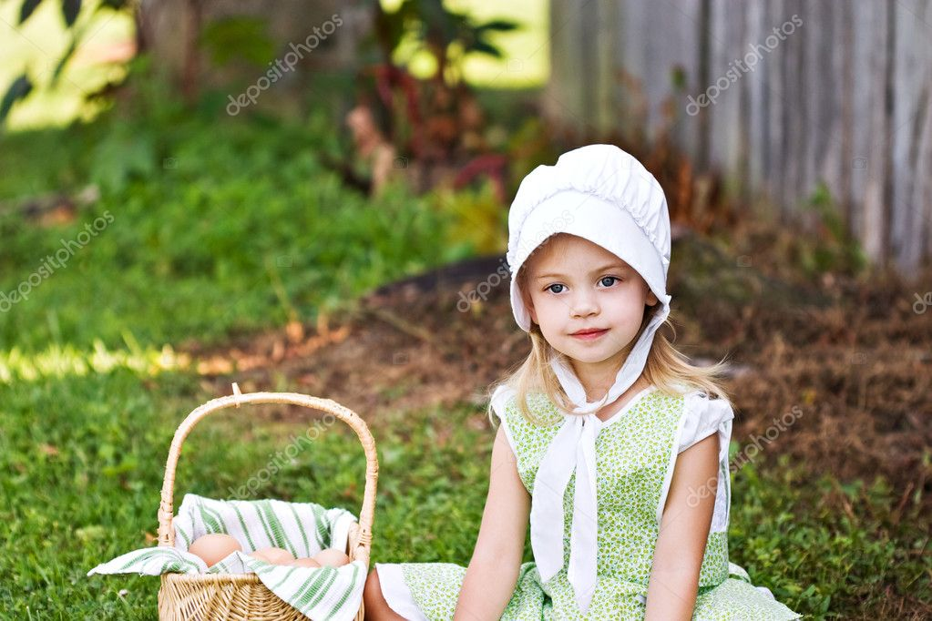 Little Amish girl gathering eggs  — Stock Photo #2593155